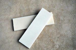 Corian white - ivory 125x70x12mm.