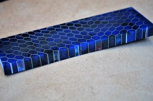 Honeycomb - blue and black with red 125x38x10 mm.